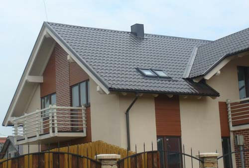 Обшитые дома имитацией бруса